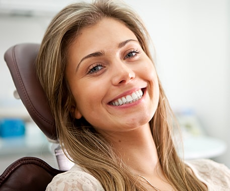smiling young woman in a dental chair