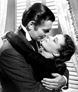 Black and white photo of Clark Cable as Rhett Butler embracing Vivian Leigh as Scarlet O'Hara in Gone with the Wind
